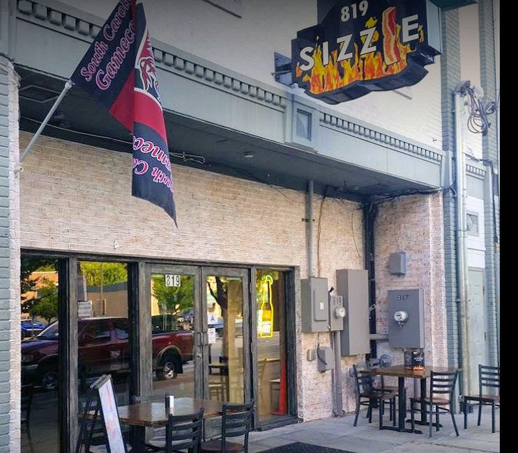 Photo of the front door to Sizzle Bacon Eatery & Pub in Columbia South Carolina